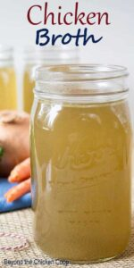 Chicken broth in a glass canning jar.