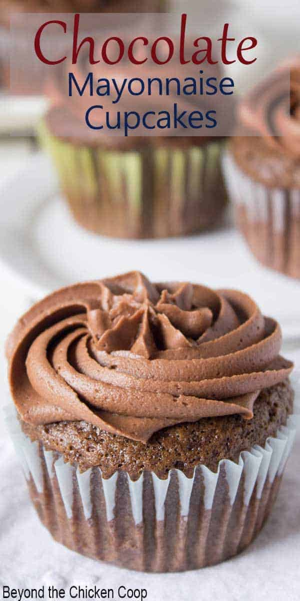 Chocolate cupcake topped with chocolate swirled frosting.
