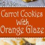 Carrot cookies with an orange glaze on a baking rack and on a wooden board.