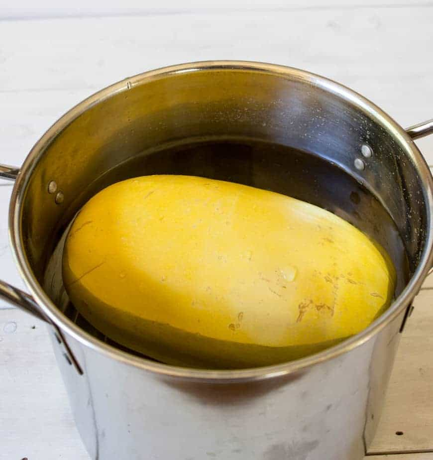 Spaghetti Squash in a pot full of water.