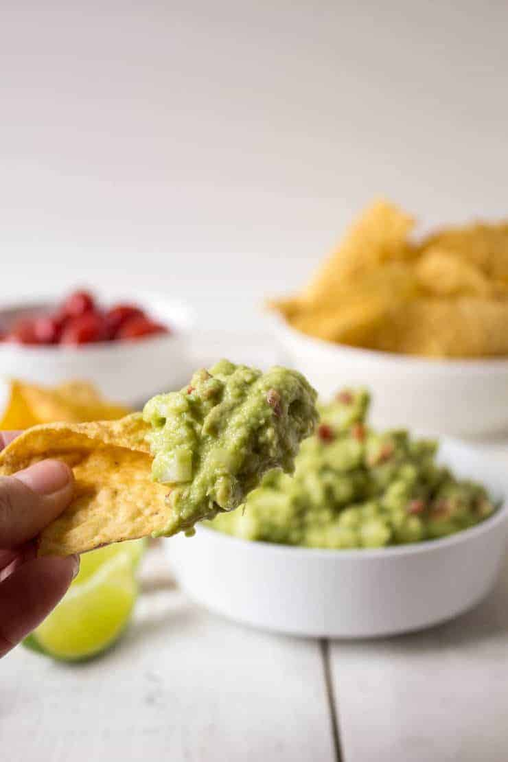 Homemade guacamole on a corn tortilla chip.