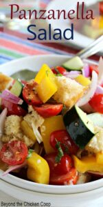 Fresh tomatoes, cucumbers, peppers and onions all mixed together in a big salad.