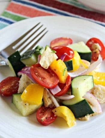 Panzanella Salad on a white plate with a fork.