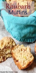 A blue napkin in a basket filled with homemade muffins.