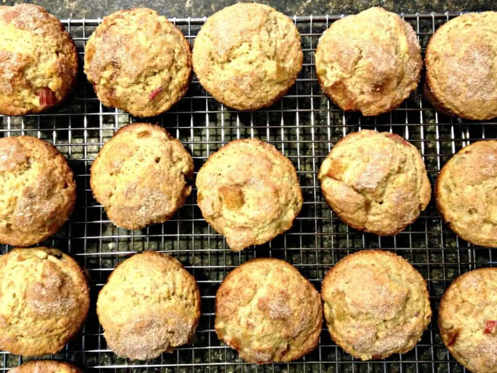 Rhubarb Muffins Cooling on a baking rack.
