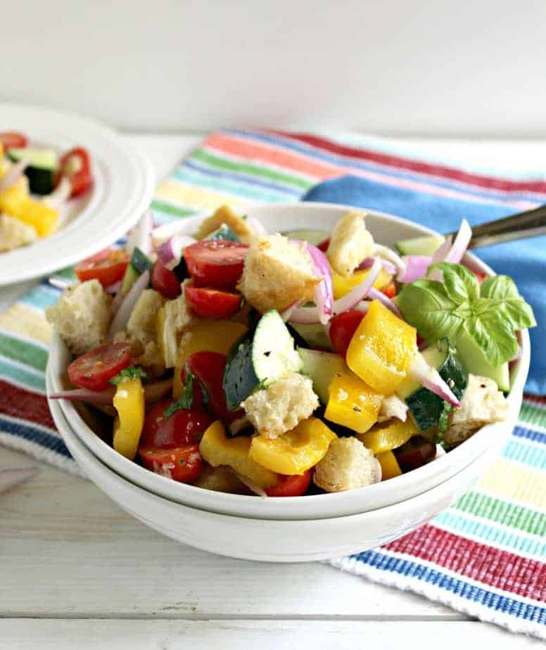 Panzanella salad filled with fresh veggies.