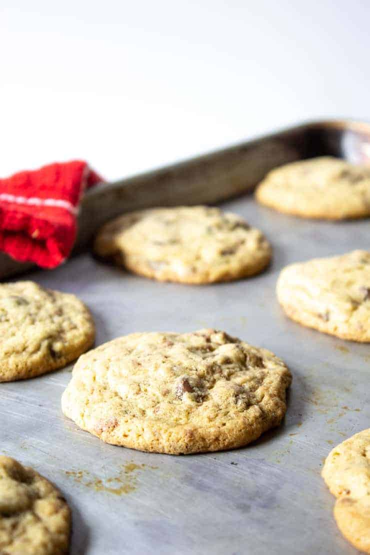Toffee Chip cookies on a baking sheet