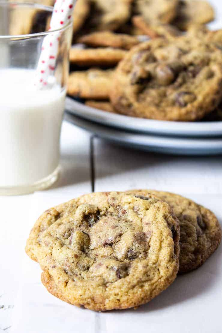 Toffee Chocolate Chip Cookies with a glass of milk.