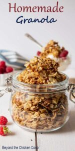 A small glass jar filled with granola.