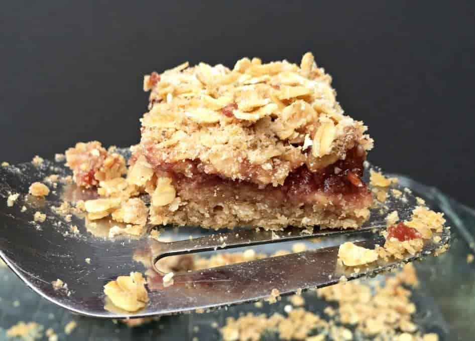 Raspberry oat bars are made easy with raspberry jam as the filling!