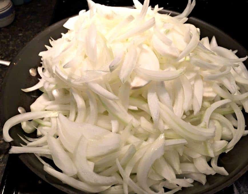 Onions just added to pan for cooking.
