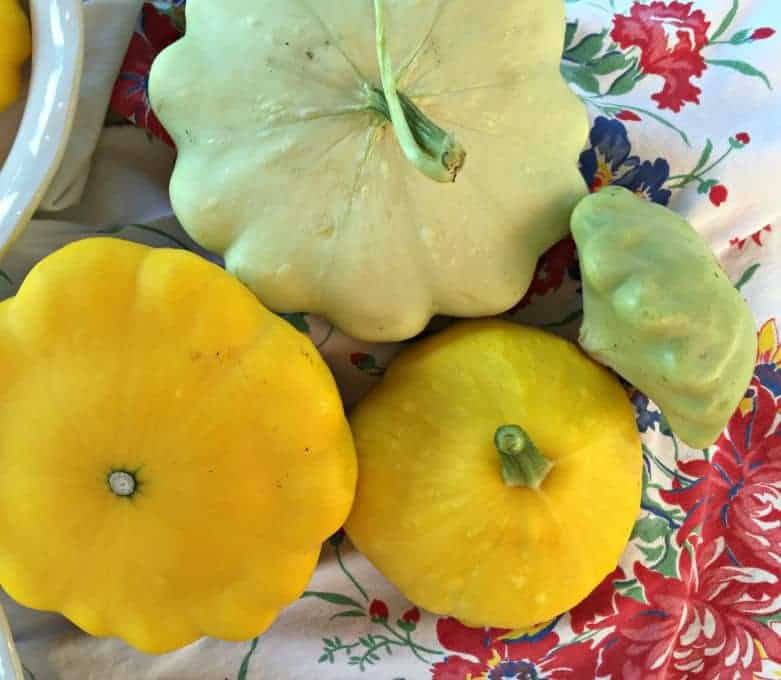 Green and yellow Patty Pan Squash is different sizes.