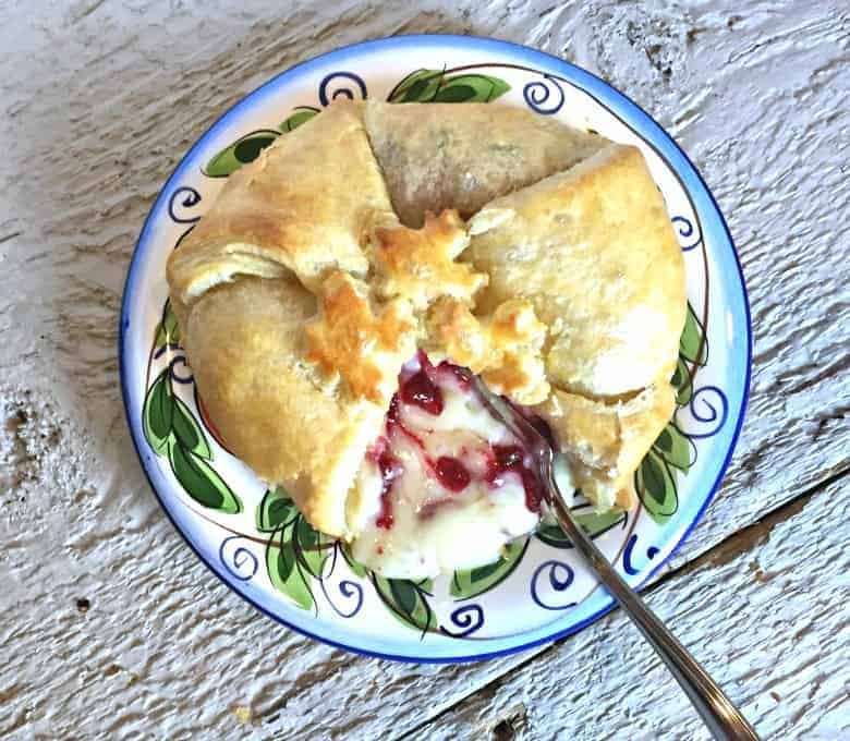 Baked brie wrapped in puff pastry with cranberries!