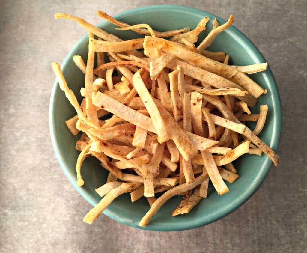 Crispy baked tortilla strips. Perfect topping for tortilla soup.