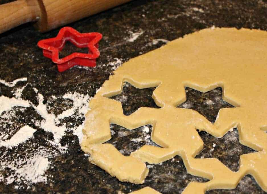 Cookie dough cut into star shapes.