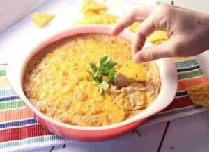 Cheesy bean dip on a corn chip.
