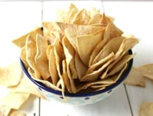 Tortilla chips piled into a small bowl.