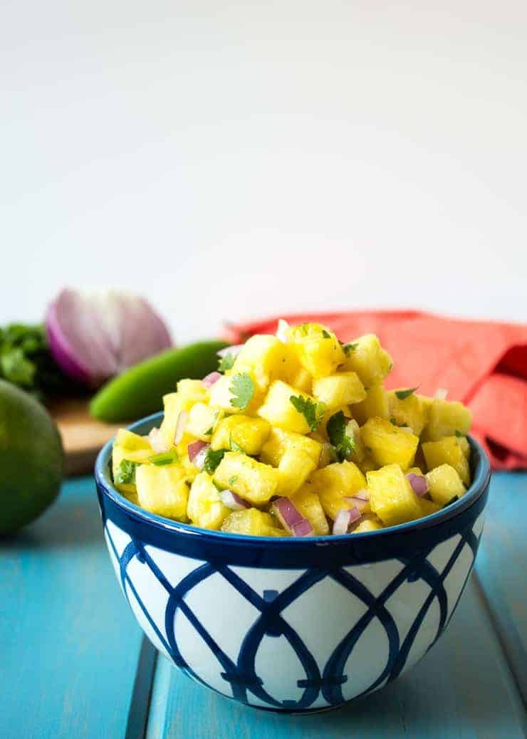 Fresh chopped pineapple with cilantro and onions.