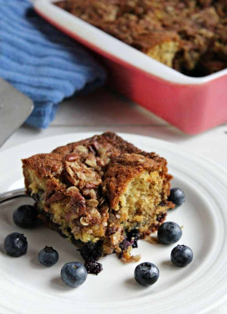 Coffee cake with fresh blueberries around the cake.
