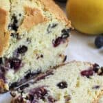 Slice loaf of bread filled with blueberries.