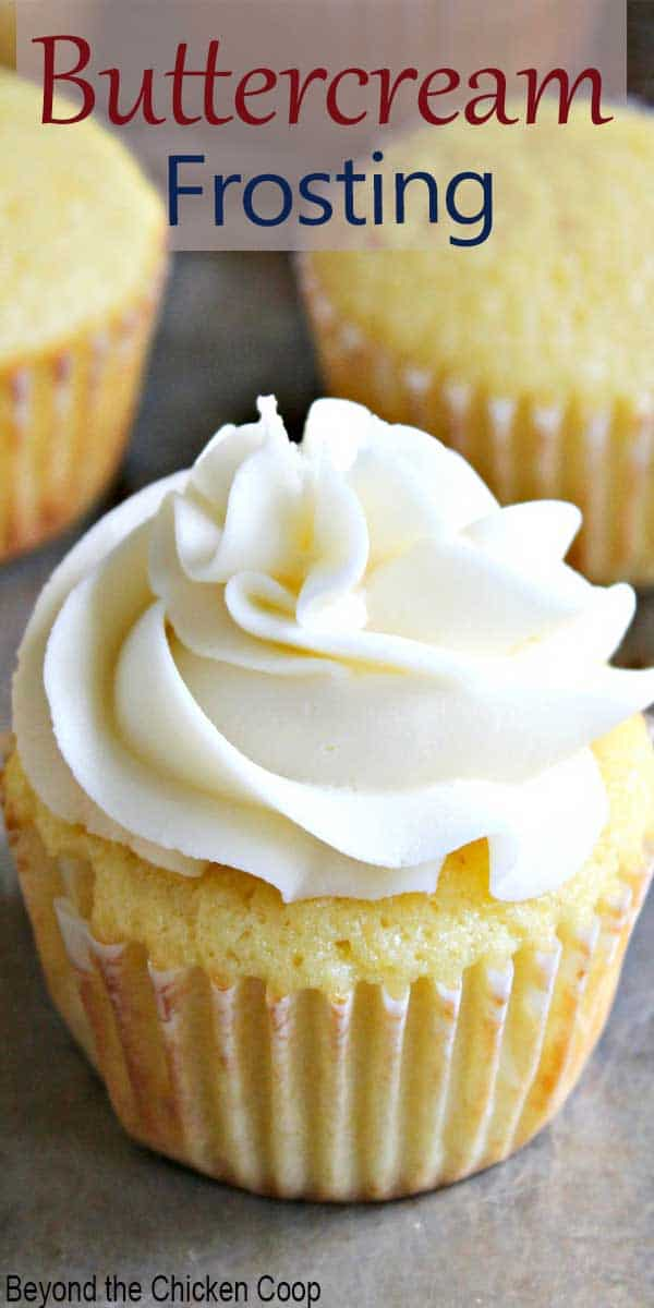 Swirled frosting on a yellow cupcake.