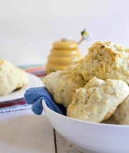 A bowl filled with drop biscuits.