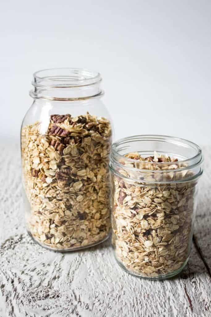 Maple Pecan Granola in glass jars.