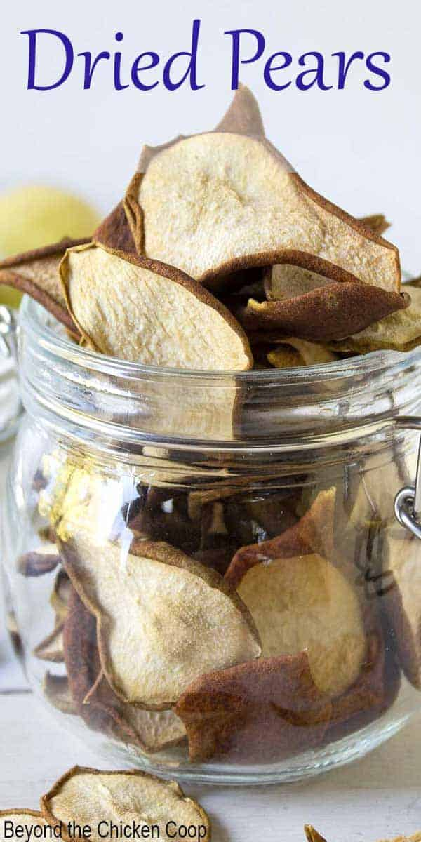 A glass crock filled with dried pears.