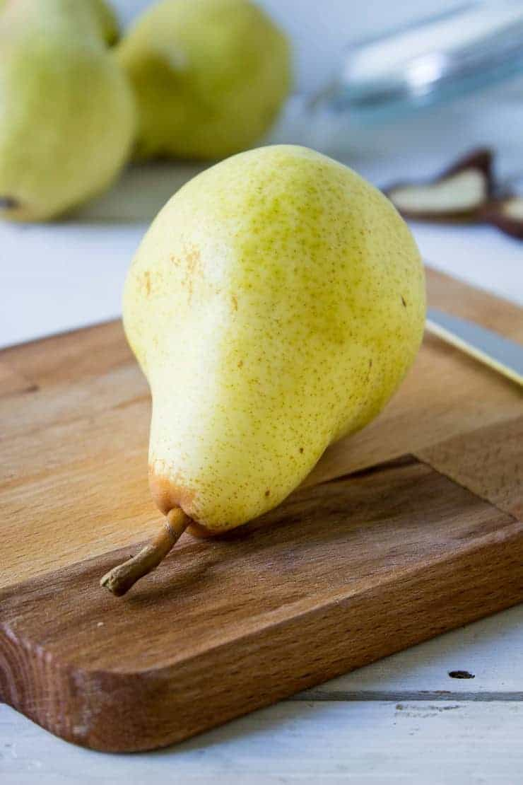 Fresh pear on a cutting board