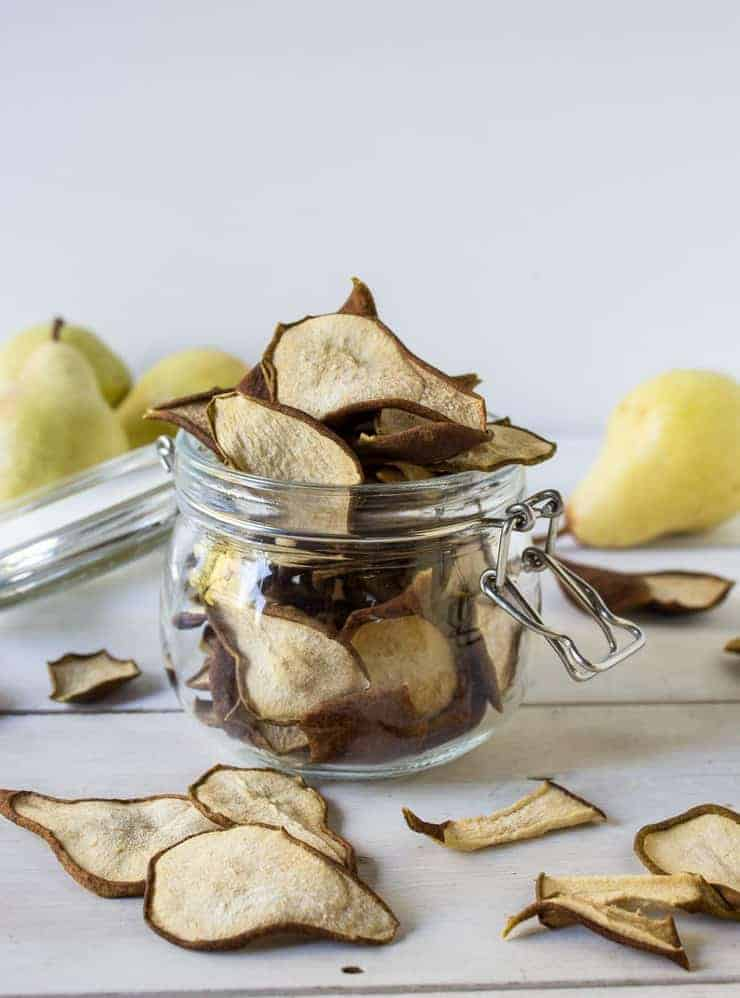 Dried pears in a jar and on a board.