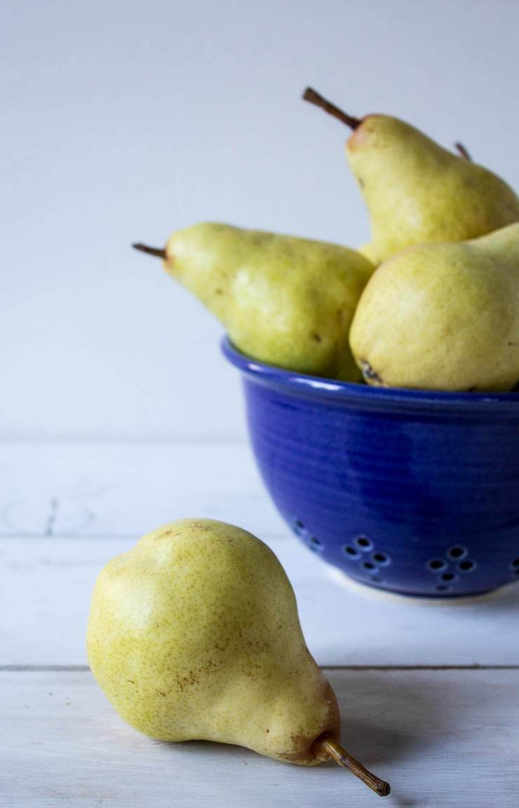 Fresh Pears in a blue bowl.