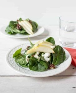 Spinach, pear and blue cheese salad with candied pecans.