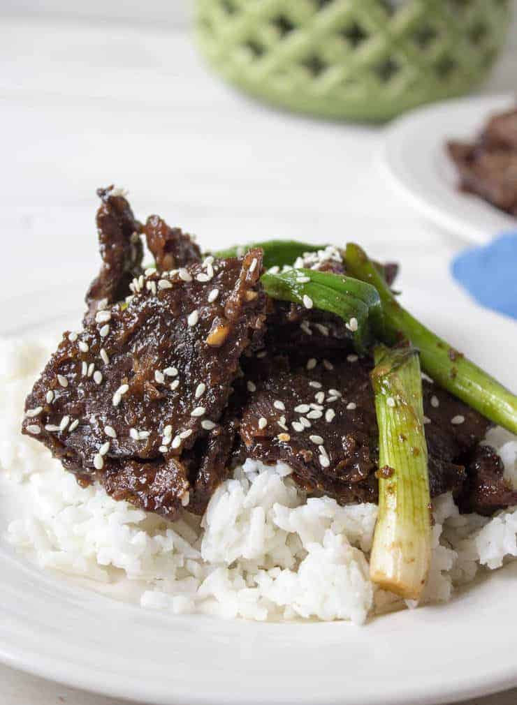 Mongolian Beef topped with sesame seeds and green onions.