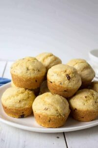 A white plate filled with cornmeal muffins.