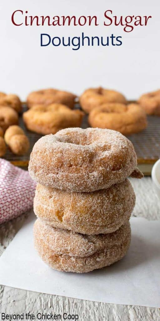 A stack of doughnuts covered with sugar.