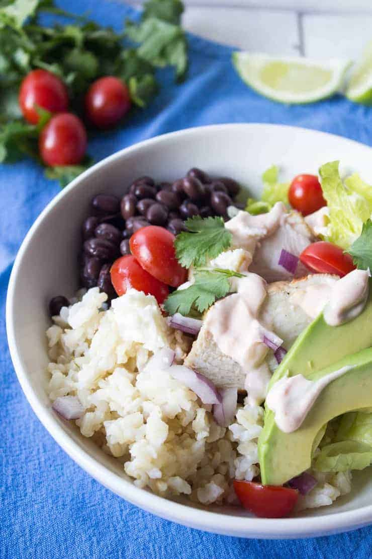 Black Bean Burrito Bowls are filled with black beans, rice, chicken and avocados.