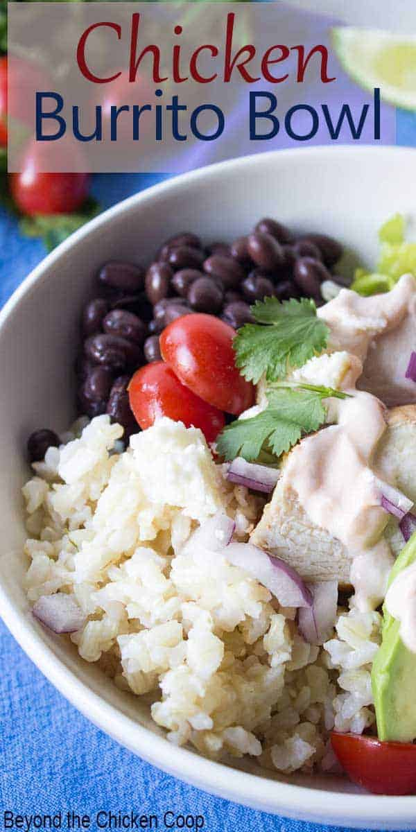 Burrito bowl filled with chicken, rice and black beans.