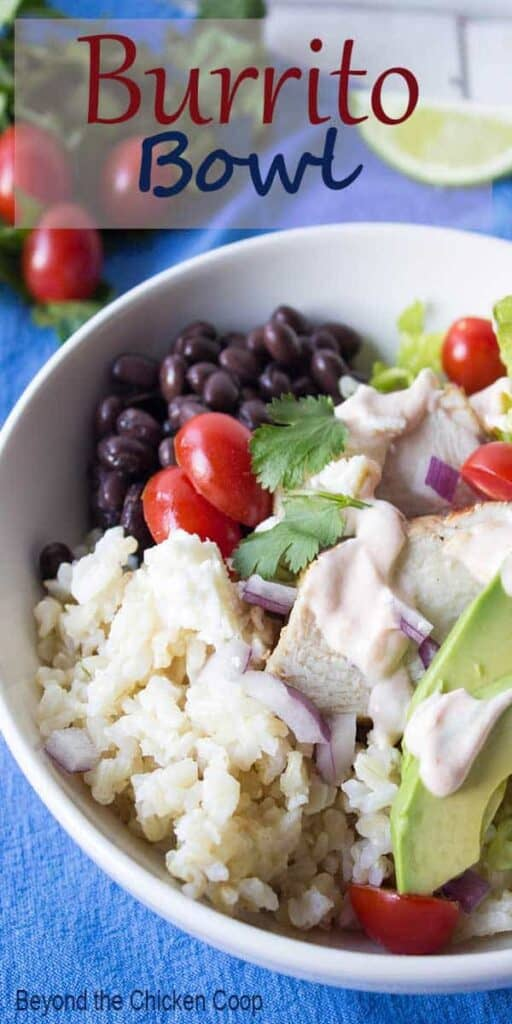 A white bowl filled with chicken, rice and beans.