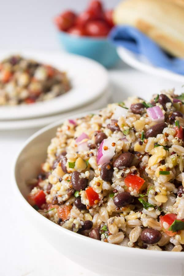Bowl with quinoa, farro and fresh vegetables.