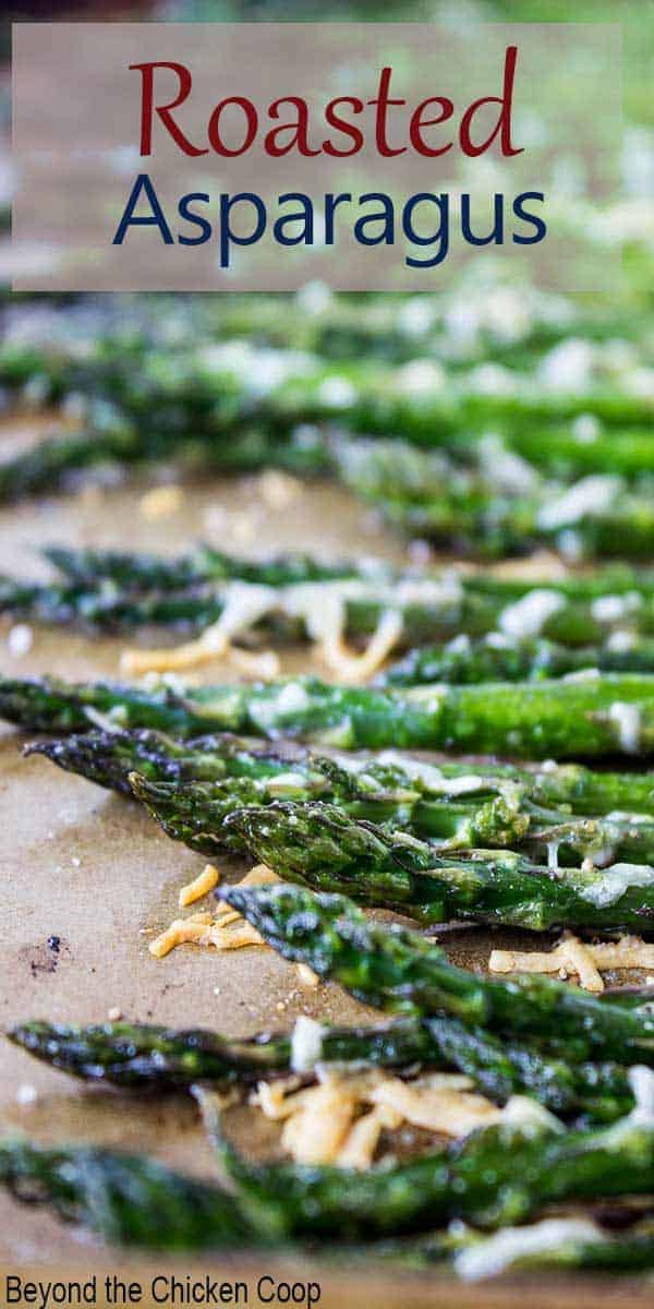 A pan filled with asparagus topped with parmesan cheese.