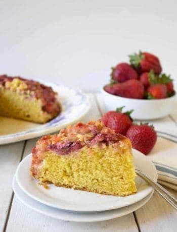 A slice of yellow cake topped with fruit.