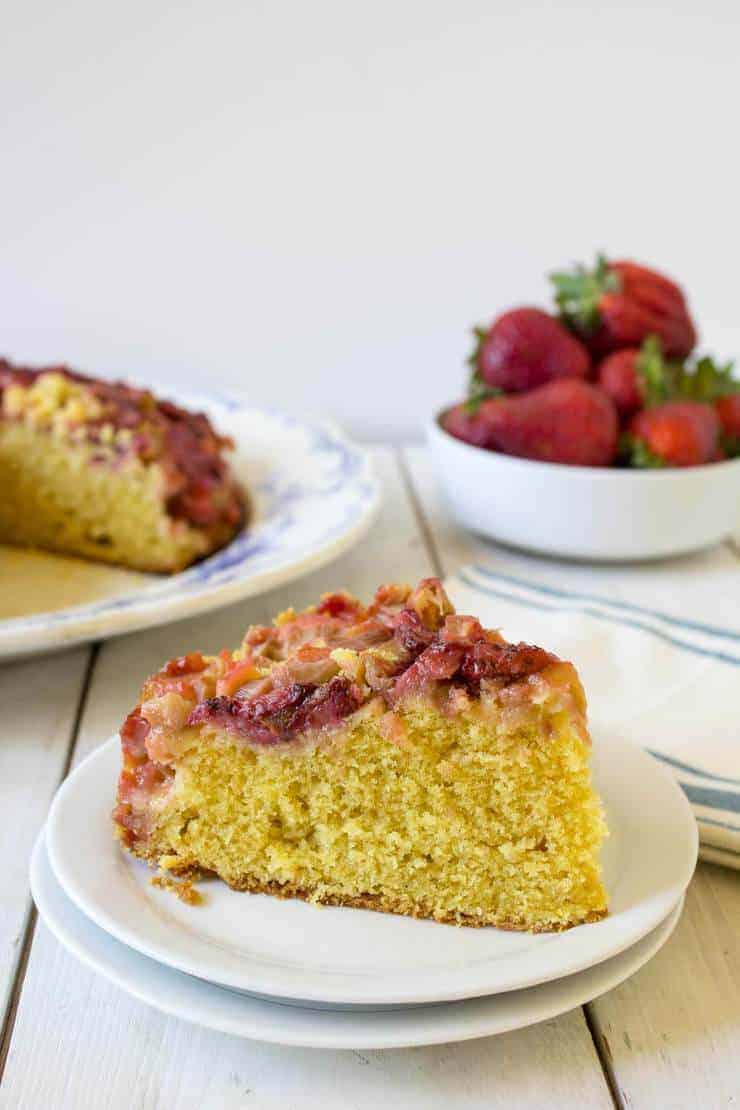 Slice of strawberry rhubarb upside down cake