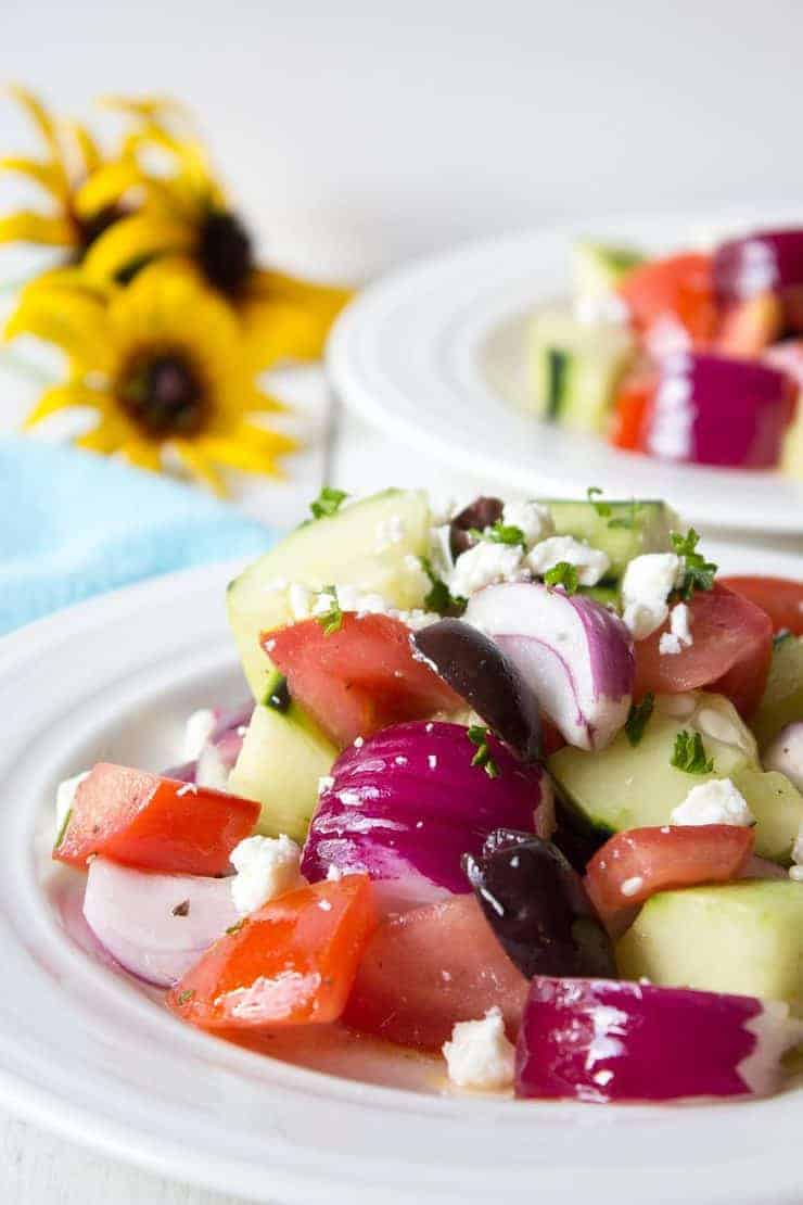 Tomatoes, Cucumbers, Red Onions and Feta are delicious in this Greek Salad.