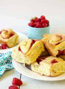Plate of delicious raspberry sweet rolls.