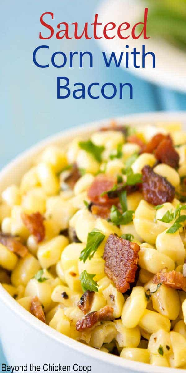 A bowl filled with corn and bits of bacon.