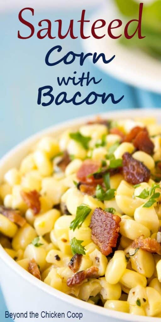 Sauteed corn with crispy bacon topped with chopped parsley