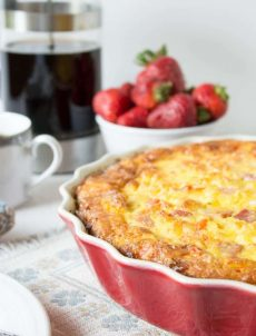 A deep dish pie dish filled with baked egg casserole.