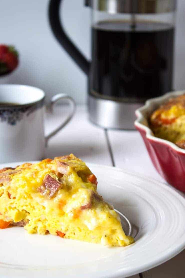 A slice of Cheesy Baked Egg Casserole for breakfast.
