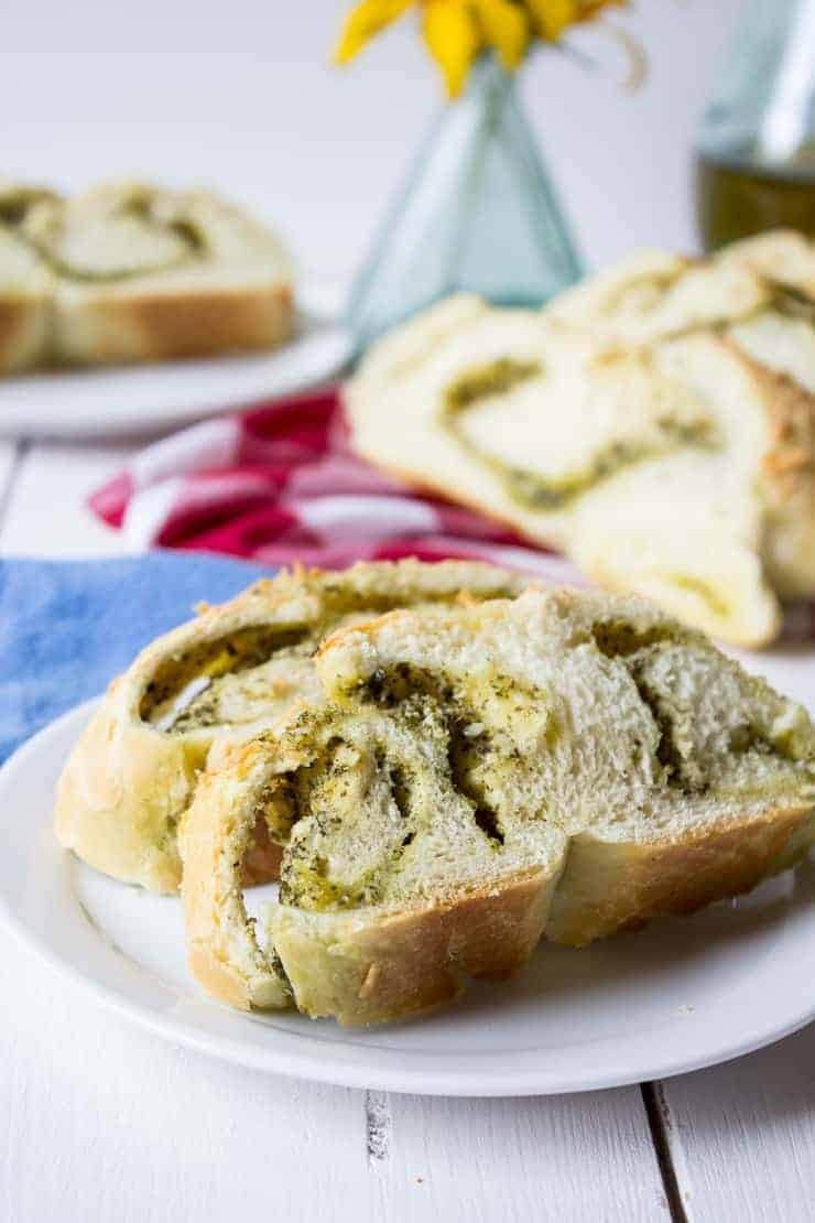 Slices of Cheesy Pesto Bread on a small white plate.