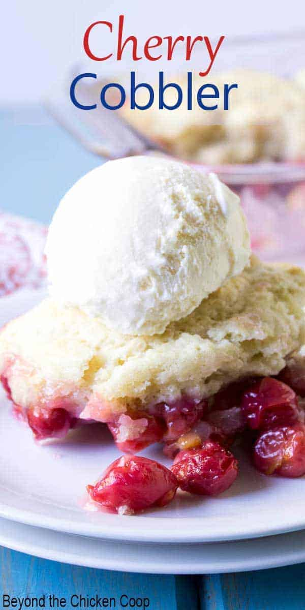 Cherry cobbler topped with a scoop of vanilla ice cream.
